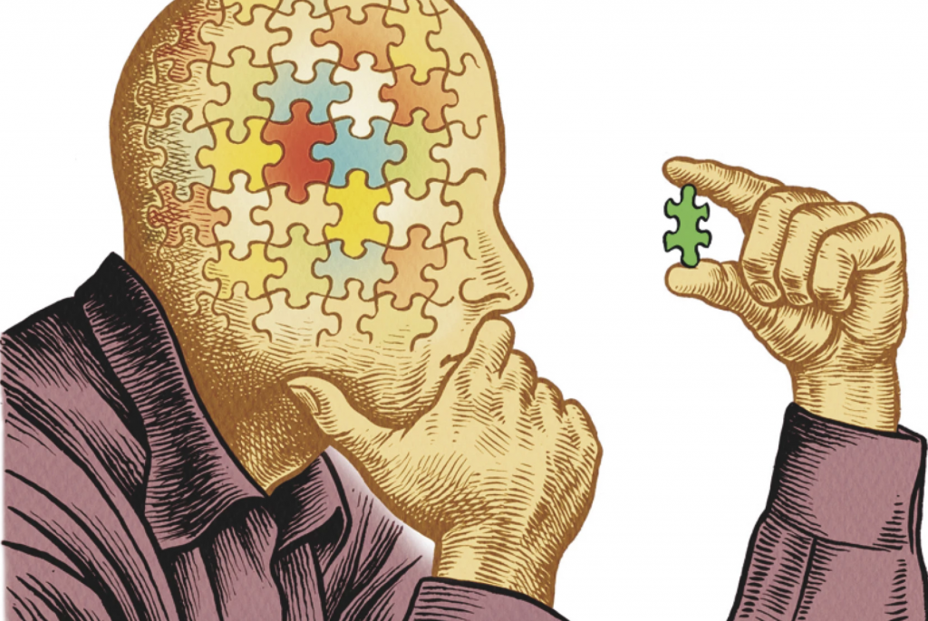 Header image. A man staring at a puzzle piece.
